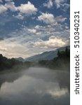 Small photo of Sentiero della Valtellina, bicycle path along the Adda river iat summer. Mist