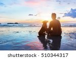 Stock photo friendship concept man and dog sitting together on the beach at sunset 510344317