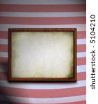 old blank wooden frame against striped background - stock photo