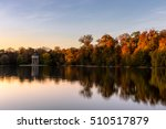 Stock photo lake in autumn with a pavilion at sunset 510517879