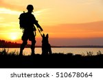 Stock photo silhouettes of soldier and dog on sunset background military service concept 510678064