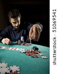 poker player throwing chips | Shutterstock . vector #51069541