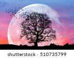 lone tree with moon at it... | Shutterstock . vector #510735799