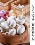 mushrooms in a bowl on a wooden ... | Shutterstock . vector #510737134