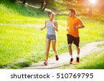 athletic couple jogging in... | Shutterstock . vector #510769795