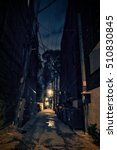 Small photo of Dark Urban Alley at Night