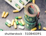 Rolled Euro Banknotes And Pill...