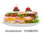 Bacon ham and cheese club sandwich with chips isolated on white background - stock photo