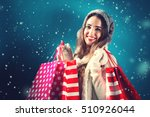 Happy Young Woman Holding...