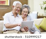 senior asian couple sharing a... | Shutterstock . vector #510999217