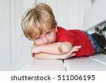 sad boy with a bandaged elbow | Shutterstock . vector #511006195