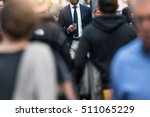 Stock photo business people walking from the job in busy city street elegant businessman in the people crowd 511065229