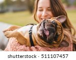 Stock photo little dog with owner spend a day at the park playing and having fun 511107457
