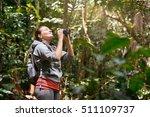 hiker watching through... | Shutterstock . vector #511109737