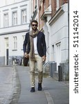 Man Walking In City Wearing...
