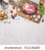 raw pork steak on a cutting... | Shutterstock . vector #511156687