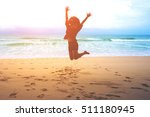 silhouettes of a woman jumping... | Shutterstock . vector #511180945