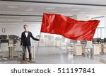 Man Waving Red Flag . Mixed...