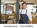 portrait of smiling owner... | Shutterstock . vector #511210861