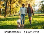 couple walking the dog together ... | Shutterstock . vector #511246945