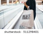 black friday. woman carrying... | Shutterstock . vector #511298401