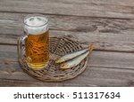 glass of beer next to   plate ... | Shutterstock . vector #511317634
