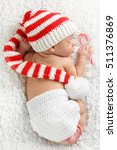 Newborn Baby Wearing A Knitted...
