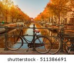 Stock photo evening over beautiful amsterdam canals in autumn bicycles parked at the bridges in the foreground 511386691