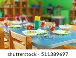 meal time in kindergarten. | Shutterstock . vector #511389697