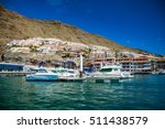 los gigantes harbor with its... | Shutterstock . vector #511438579