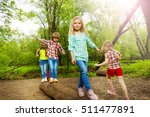 happy kids walking on log and... | Shutterstock . vector #511477891