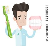 young friendly dentist holding...   Shutterstock .eps vector #511485334