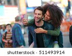 couple at times square taking... | Shutterstock . vector #511493914