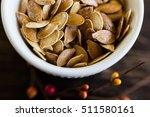 fresh roasted pumpkin seeds  | Shutterstock . vector #511580161