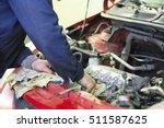 worker repairs a car in a car... | Shutterstock . vector #511587625