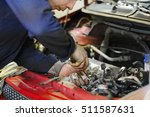 worker repairs a car in a car... | Shutterstock . vector #511587631