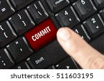 Small photo of commit word on red keyboard button