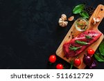 fresh raw meat with spices.... | Shutterstock . vector #511612729