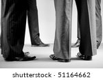 group of corporate men in suits - stock photo