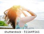 brunette girl sitting on the... | Shutterstock . vector #511649161