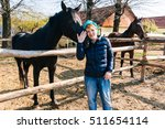 woman nuzzling horse in outdoor ... | Shutterstock . vector #511654114