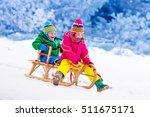 little girl and boy enjoy a... | Shutterstock . vector #511675171