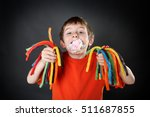 young boy holding colorful... | Shutterstock . vector #511687855