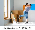 happy young couple moving in... | Shutterstock . vector #511734181