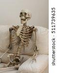 skeleton sitting in white chair ... | Shutterstock . vector #511739635