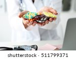 female doctor hand holding pack ... | Shutterstock . vector #511799371