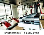 rows of stainless dumbbell in... | Shutterstock . vector #511821955