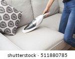woman with handheld vacuum... | Shutterstock . vector #511880785