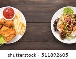 fresh salad and fried chicken... | Shutterstock . vector #511892605