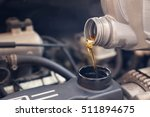 pouring oil to car engine ... | Shutterstock . vector #511894675